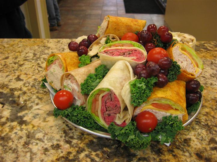 Wraps and fruit on platter for an event
