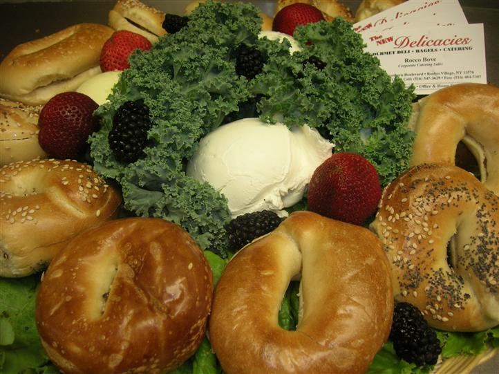 Bagels and fruits in a basket for a event