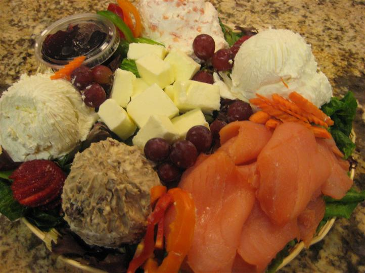 Meats, cheeses, and fruit in basket