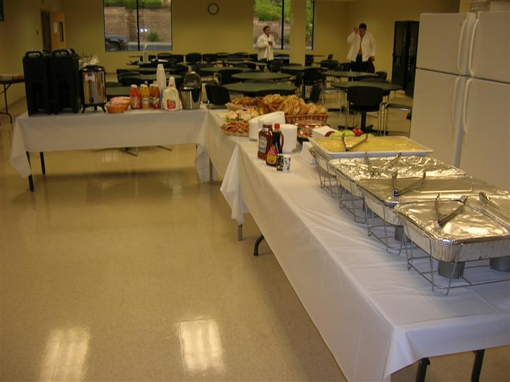 Catering tables being prepared for an event