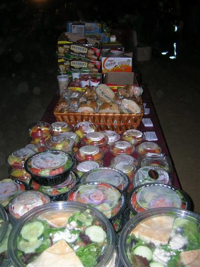 Wraps and salad on catering table