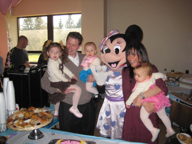 Minnie mouse taking photo with a family
