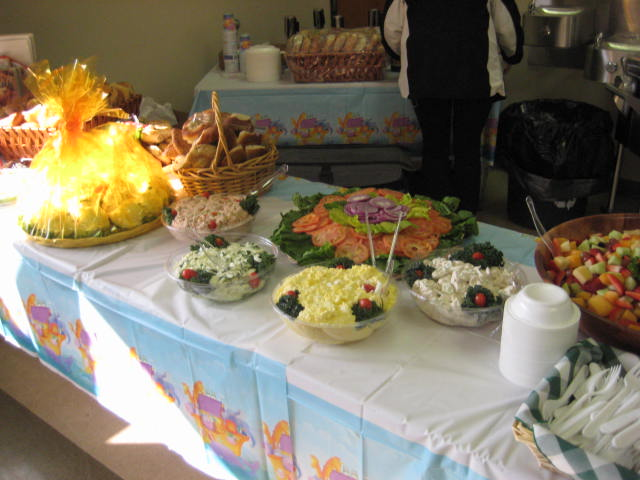 Catering table with vegetable and cheeses on it