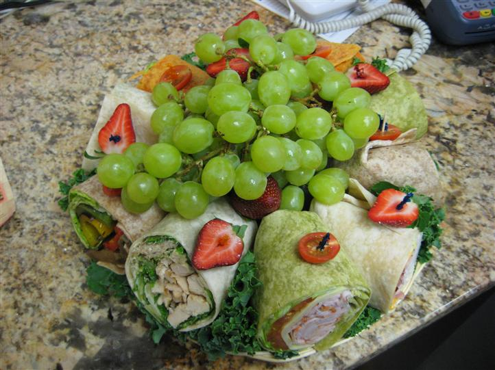 Wraps and fruits on a platter
