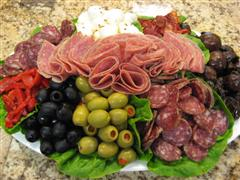 Platter of deli meats, cheeses, and vegetables