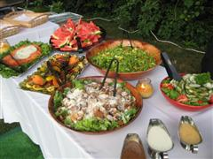 Catering event with multiple foods on a table