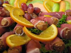 Stuffed ham horderves with orange slices