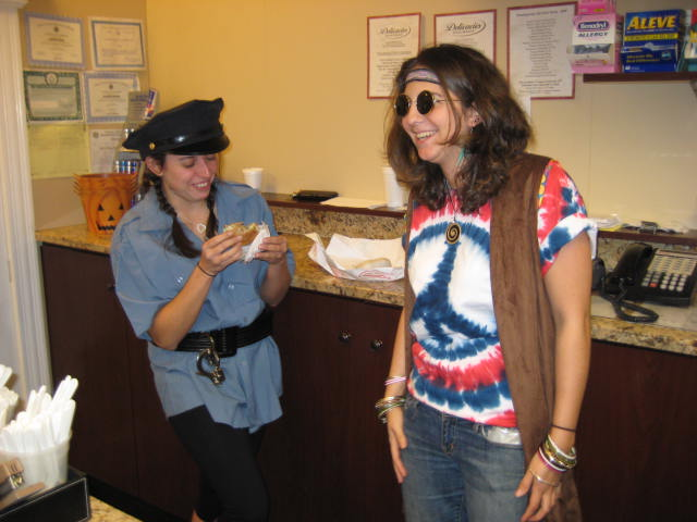 One person in a hippie costume and one person in a police costume