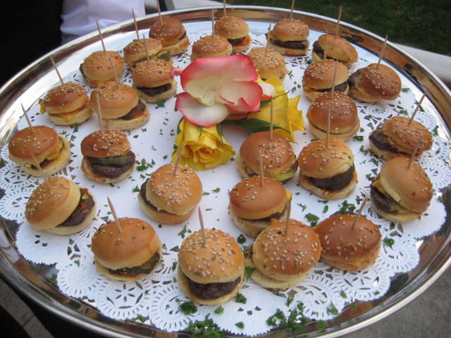 Mini hamburger horderves on a platter.