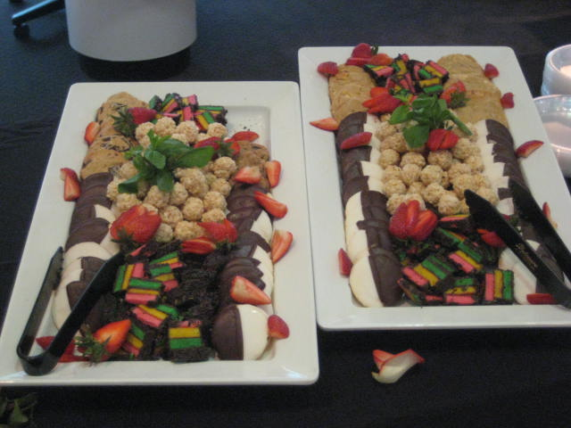 Desserts and strawberries on multiple platters