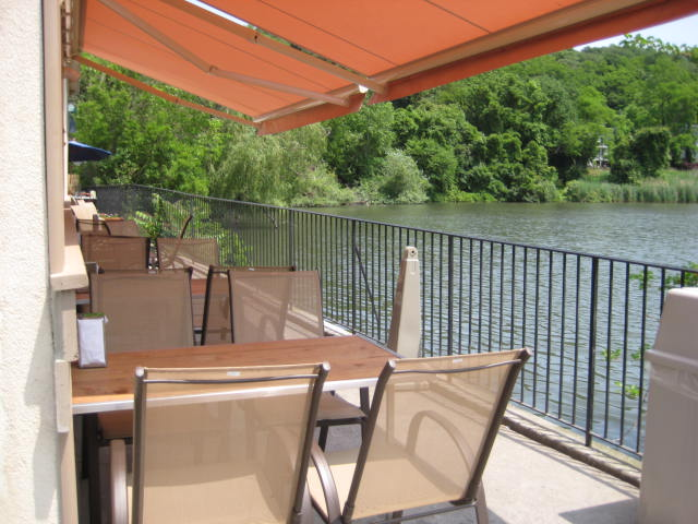 Patio dining area alongside lake