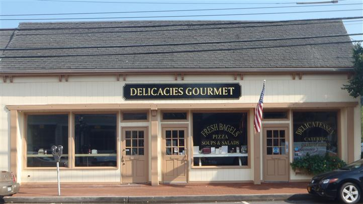Delicacies Front entrance and sign with American flag