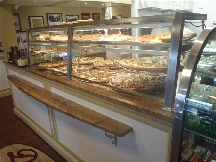 Multiple pizza pies on display