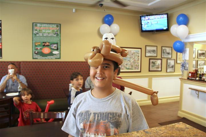 Boy with ballon hat