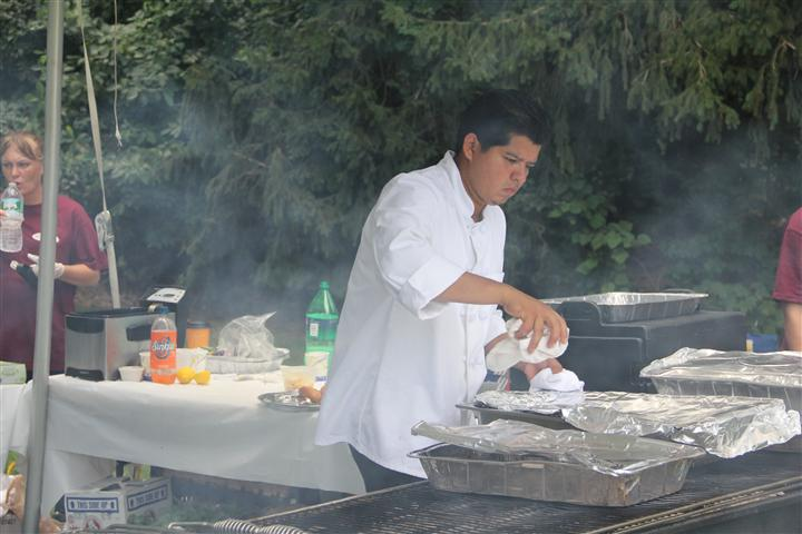 Chef preparing food on a grill