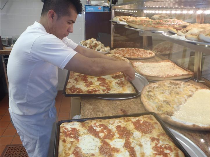 Chef preparing pizza pies