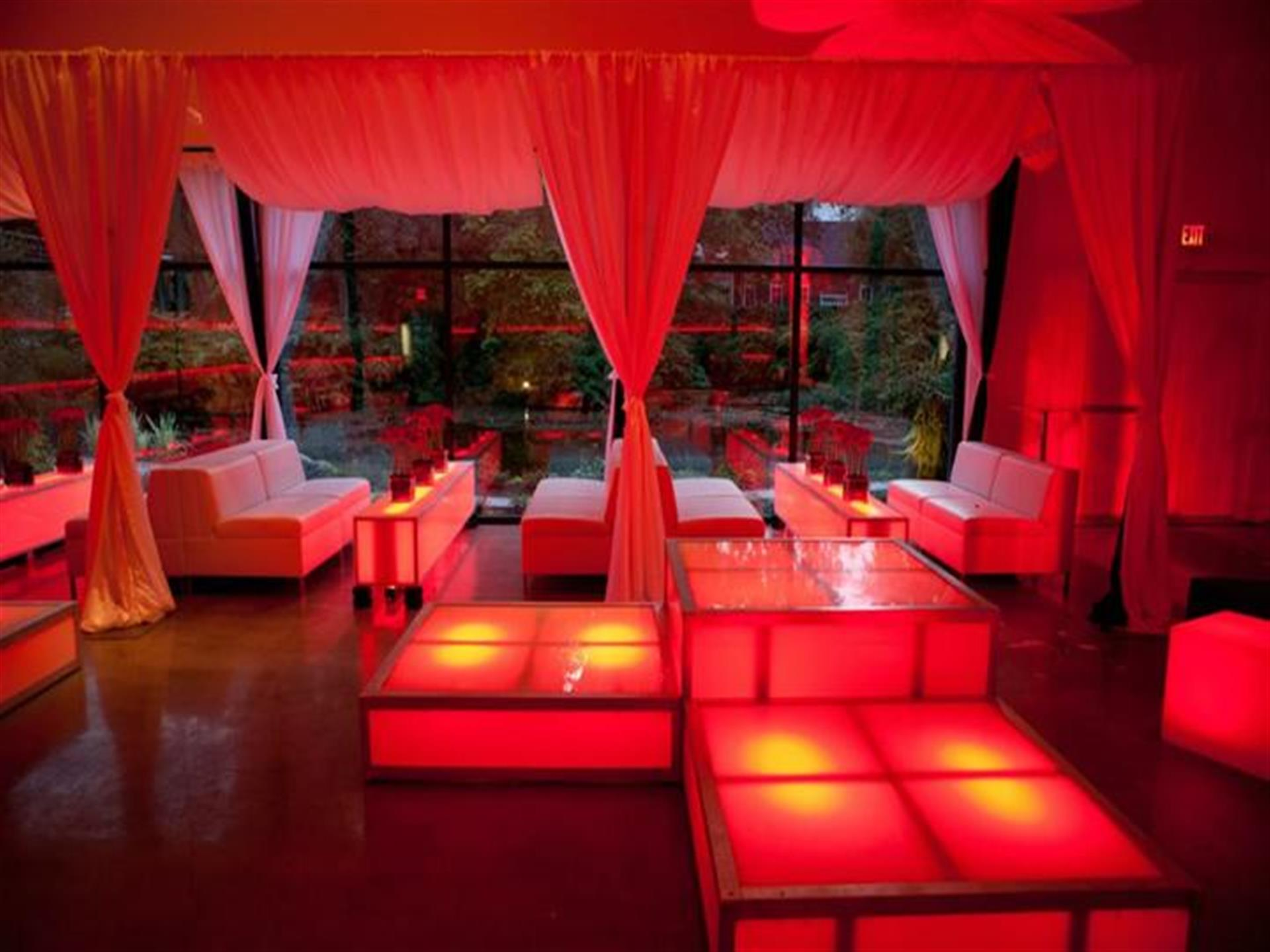 haute durvo venue hall with various couches and tables setup in a lounge area