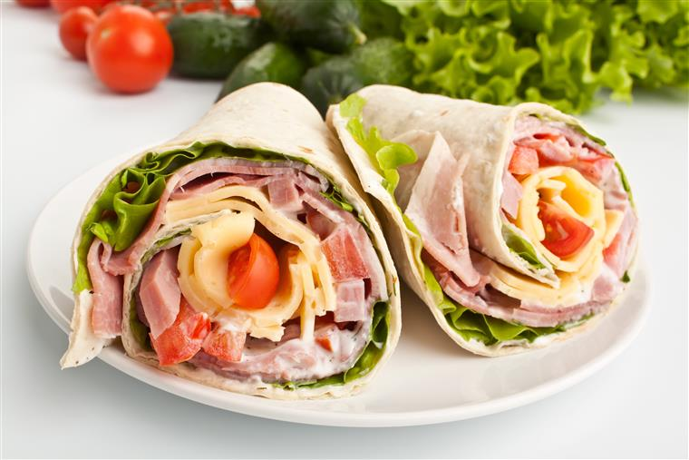 Gourmet Signature Wraps of meat, cheese, lettuce and tomatoes