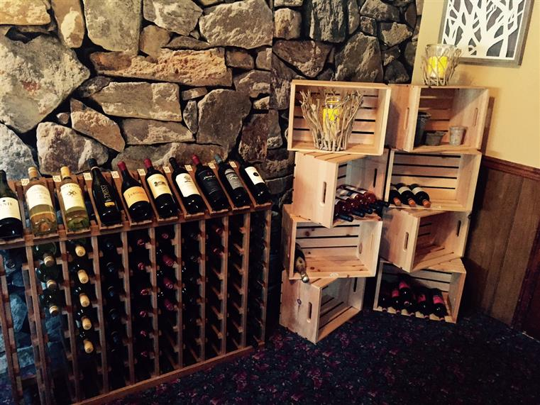 wooden wine rack stocked with various wines