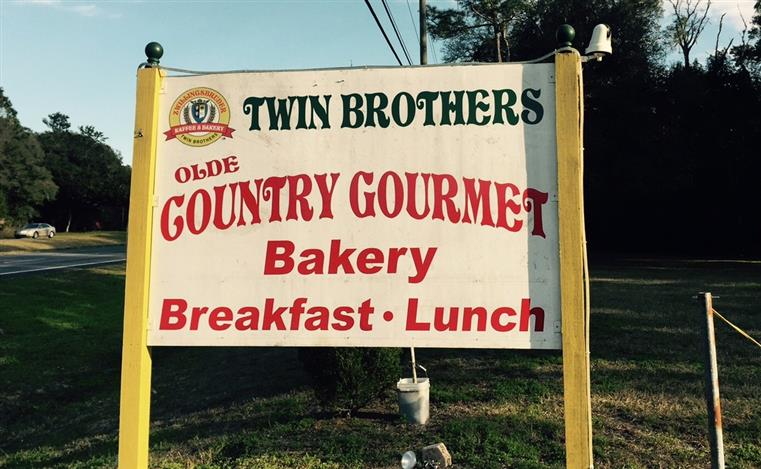 sign that reads twin brothers olde country gourmet bakery breakfast-lunch