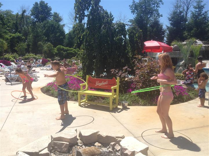 kids hula hooping by the pool