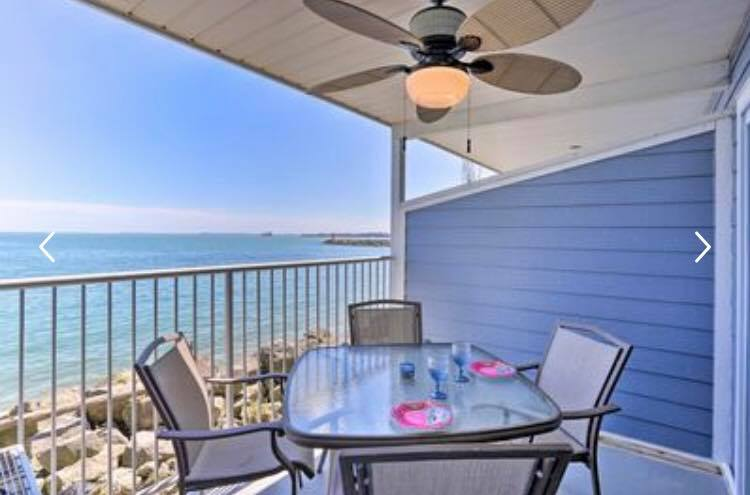 waterfront balcony with dining table and chair