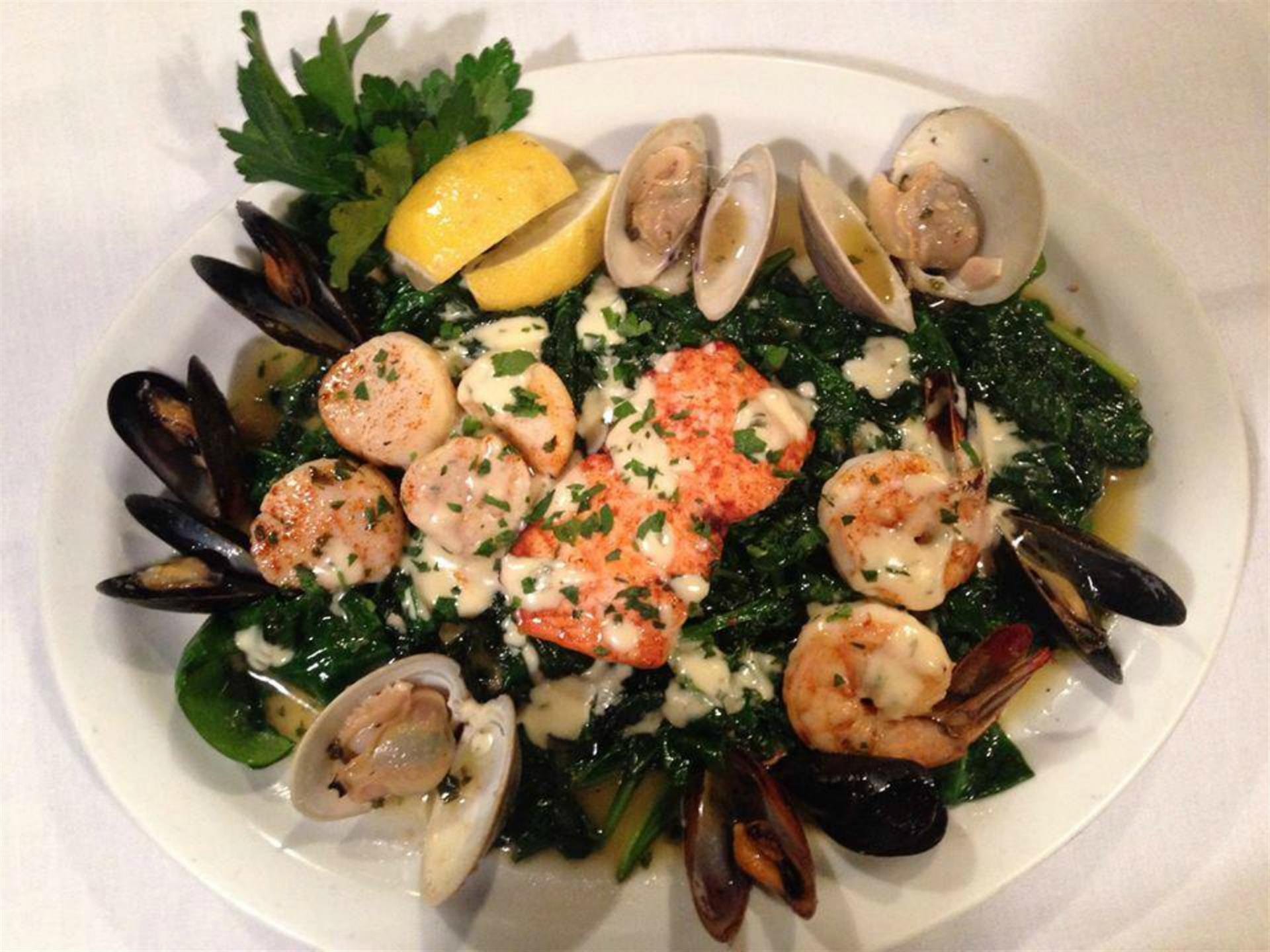 Salmon, shrimp, clams and mussels plate
