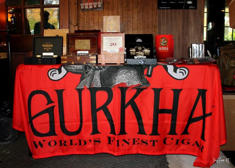 Cigar boxes on table with table cloth reading Gurkha, World's Finest Cigar