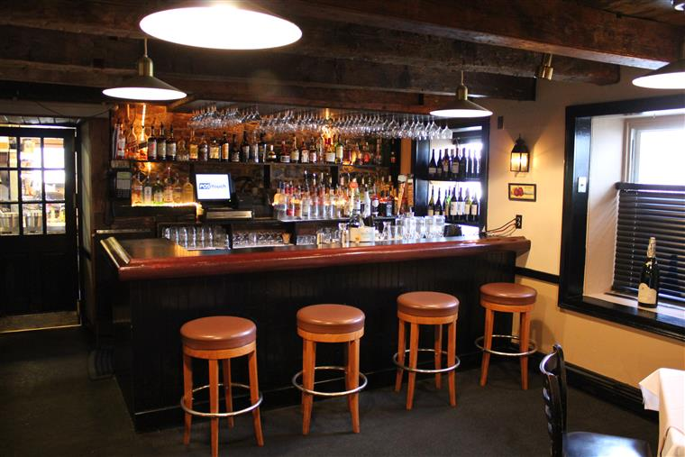 Bar, barstools and liquor shelf