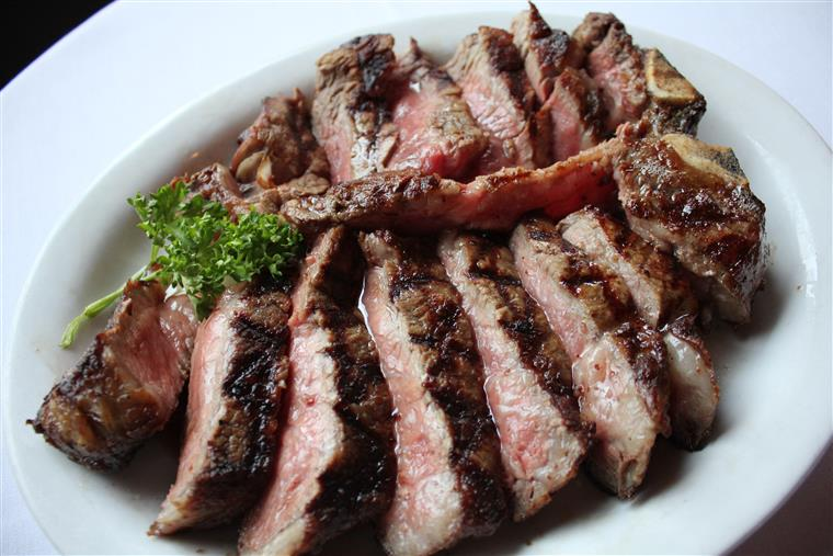 Sliced steak in white plate