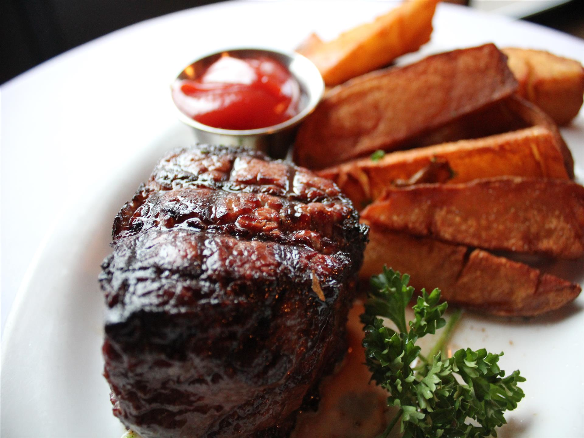 Steak and fries on white plate