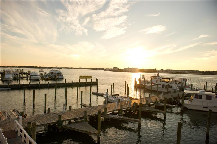 view of sunset with boats docked