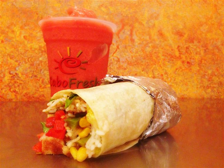 a burrito and a red drink