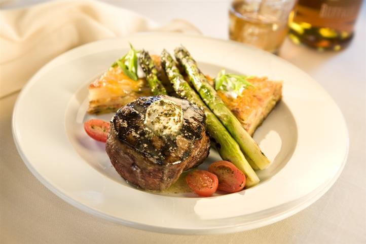 Filet mignon served with asparagus, cherry tomatoes and pies