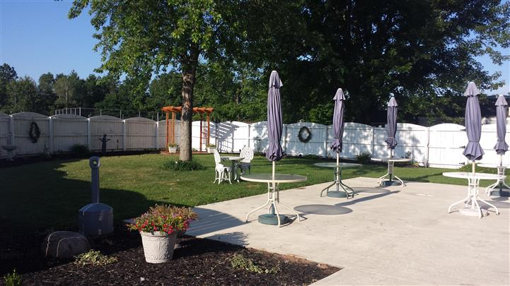 Outdoor shot of Bella Domani's garden tables with umbrellas
