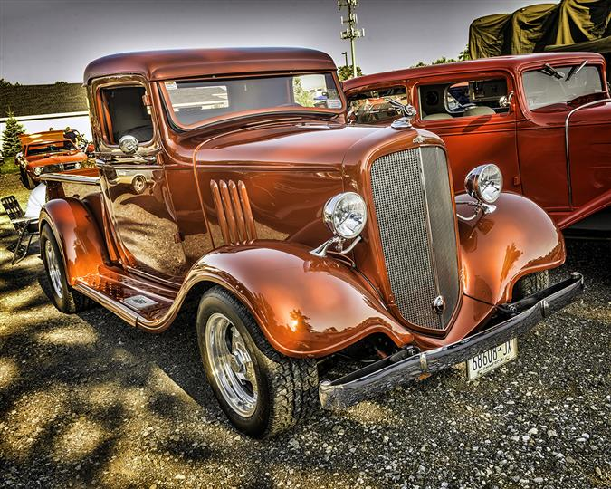 A bright brown antique car