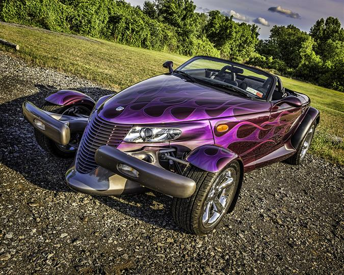 A dark purple antique racing car
