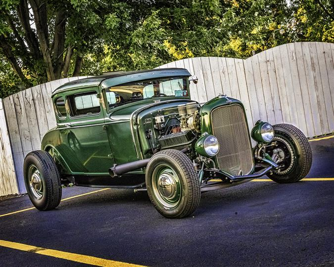 A dark green antique car