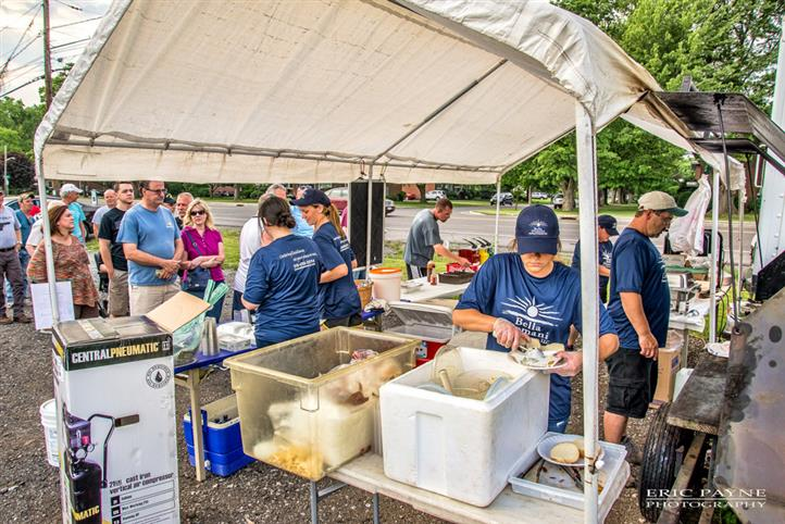 People behind Bella Domani Catering buffet serving