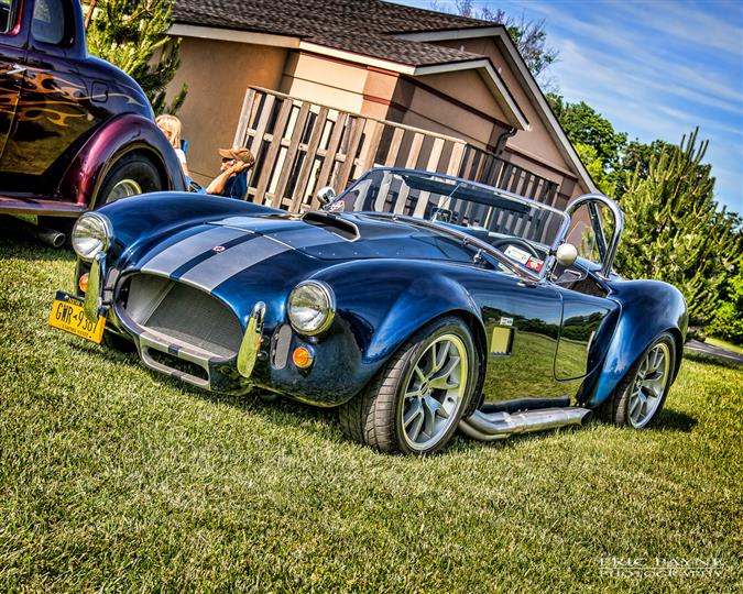 A blue antique sports car