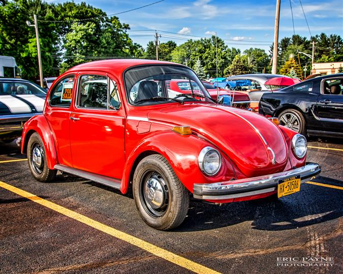 A bright red Volkswagen Beetle