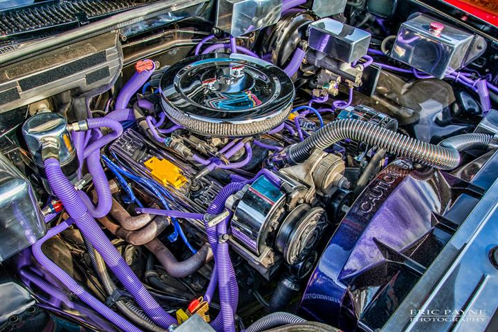 A bright purple car engine