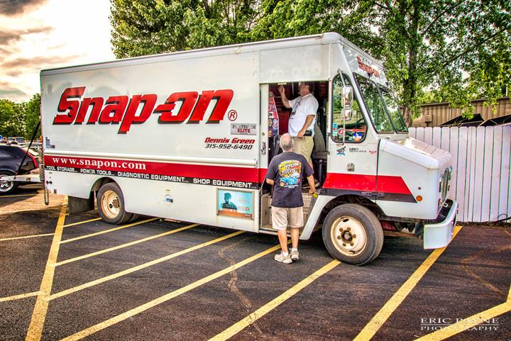 A Snap-on vehicle with two men