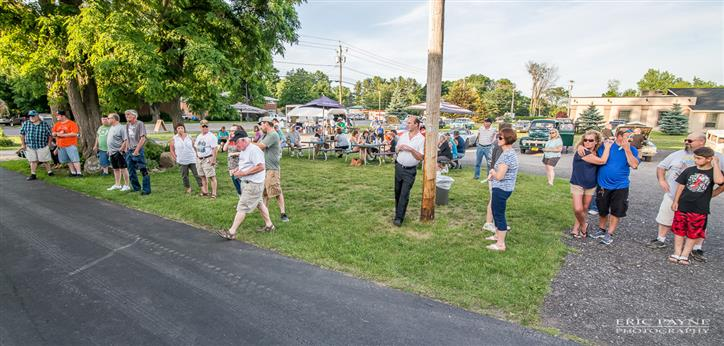 People standing outdoor during the antique cars fest