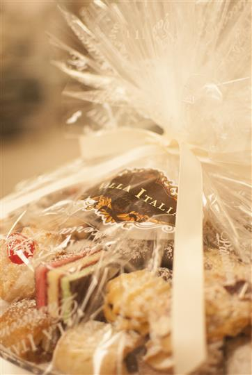 various assortment of pastries wrapped in a gift basket