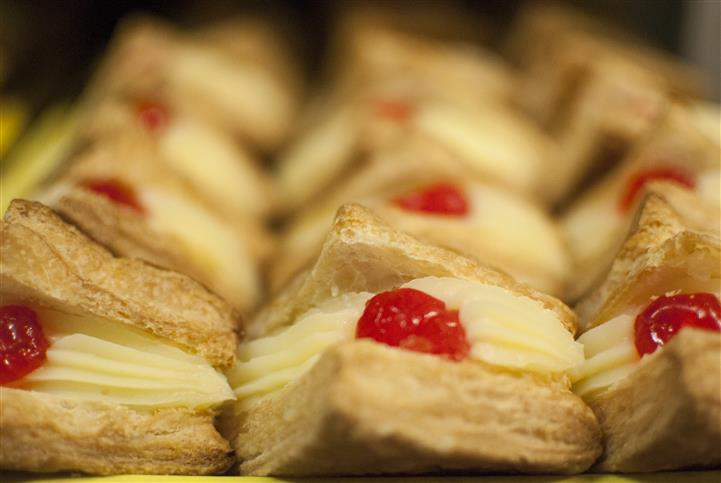 pastries with cream and a cherry