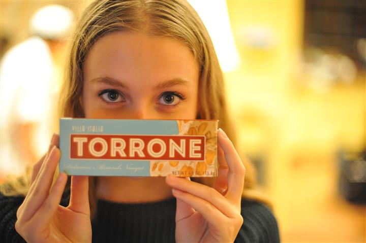 woman smiling holding a torrone box