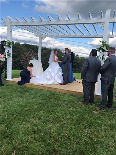 bride and groom at outdoor alter