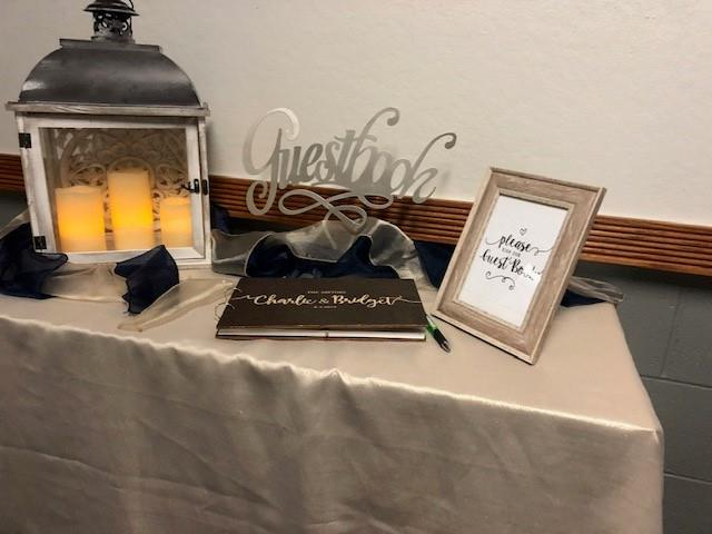 table topped with a guest book and decor