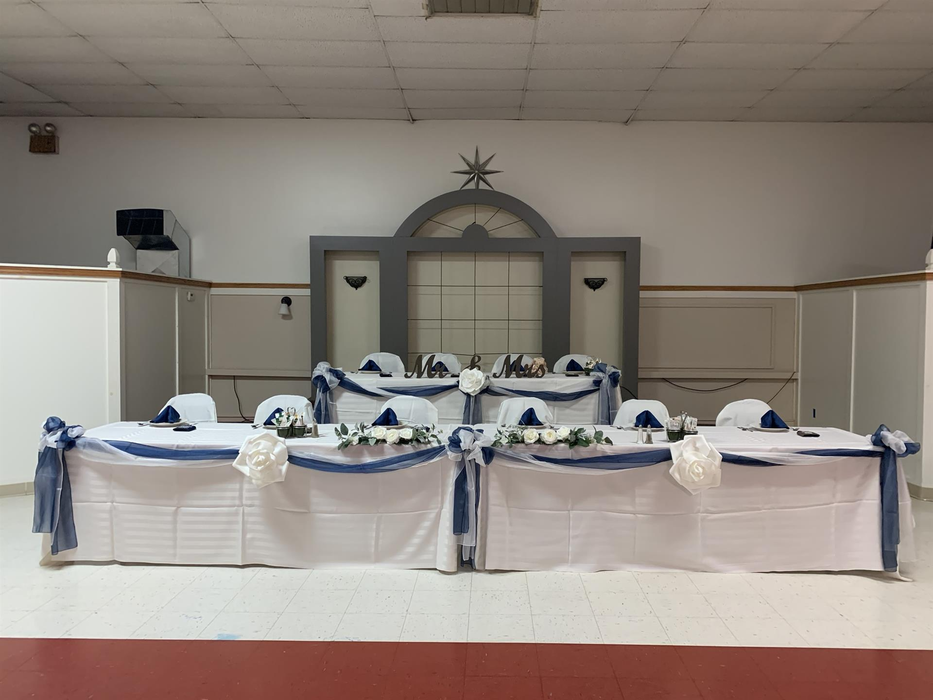 Three tables set with wedding decor.